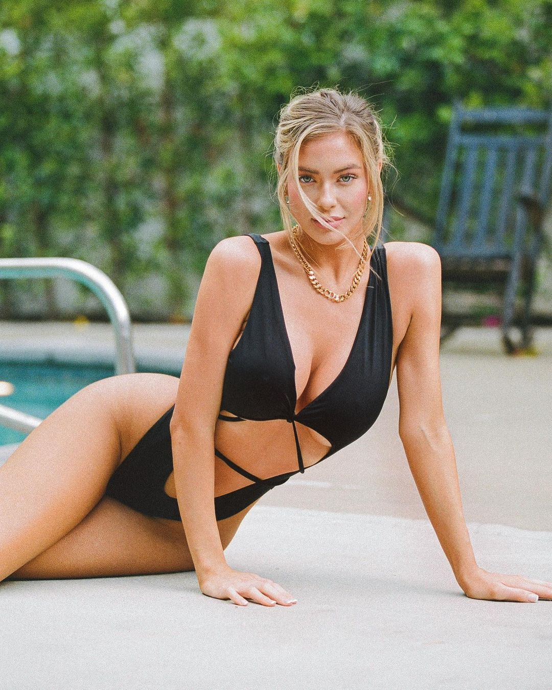 Hannah Palmer is a Blonde Model in a Unique Black One Piece Swimsuit 4