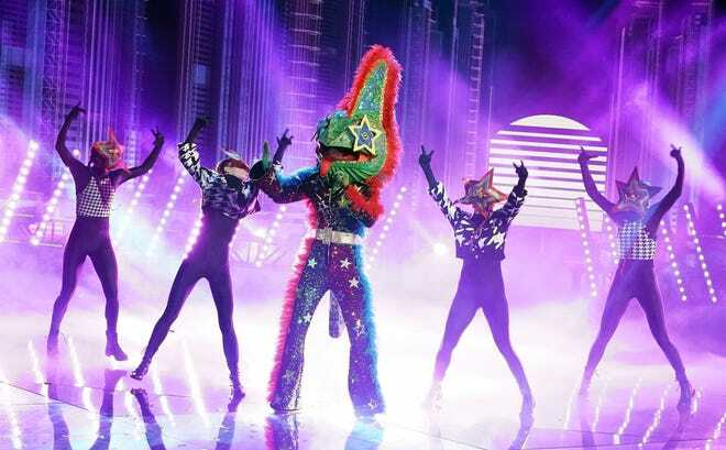 Masked Singer Nick Cannon announced as the Bulldog 4
