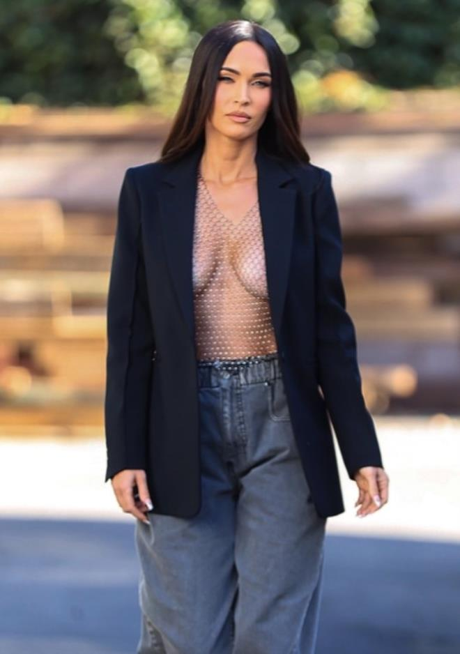 Megan Fox walks the streets in her open chested jacket 1