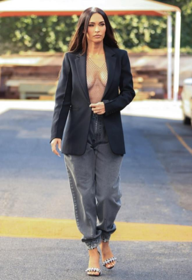Megan Fox walks the streets in her open chested jacket 3