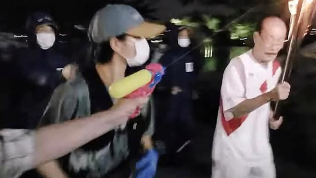 Historical Olympic torch attacked with toy water gun 2